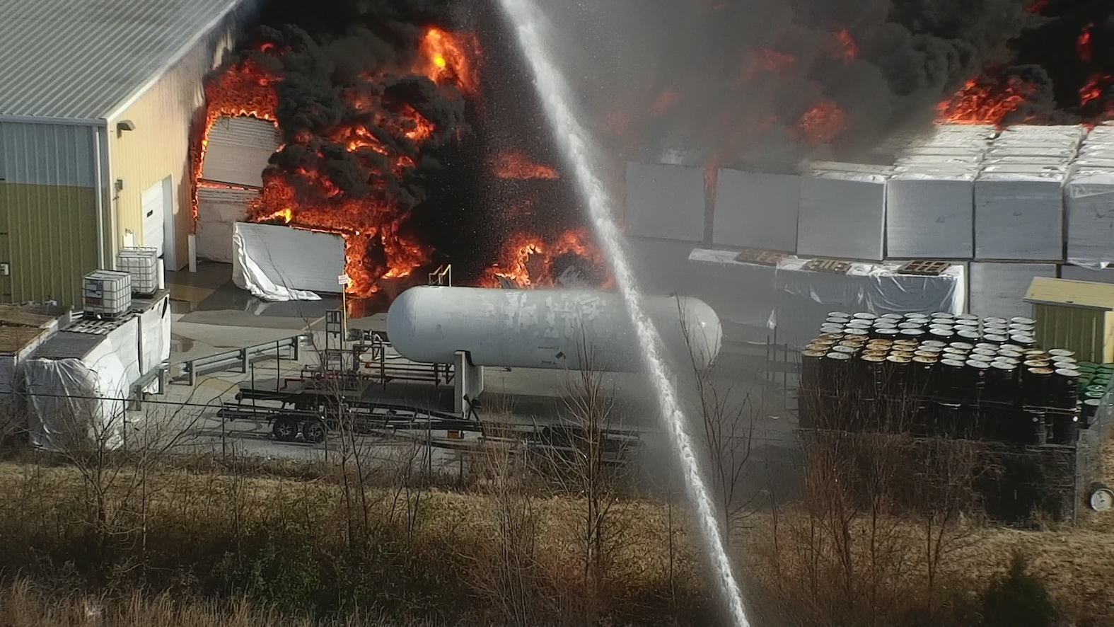 Drone close-up on a volatile industrial fire