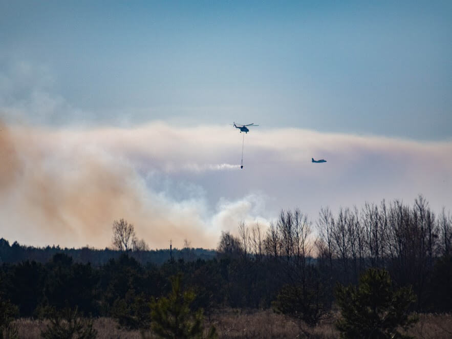 Helicopters and planes deployed to drop water on the blaze