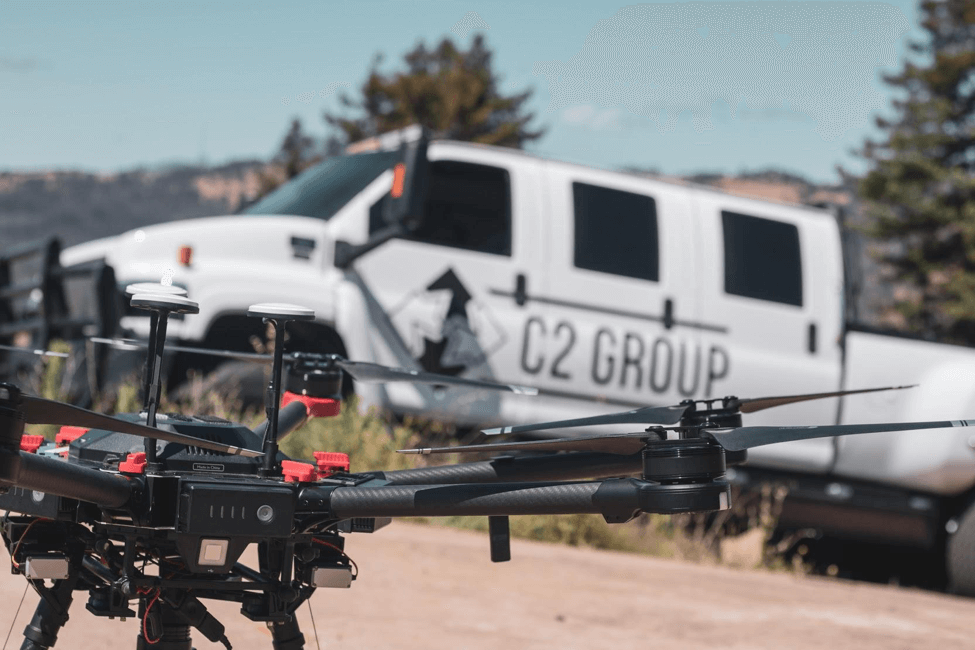 One of C2's DJI M600s in the field, with a C2 vehicle in the background