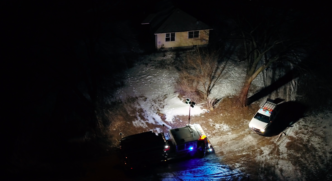 officers and the armed suspect negotiate at night