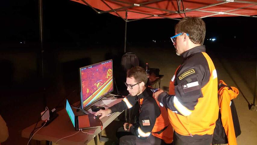 DroneSAR Chile team looking at drone imagery